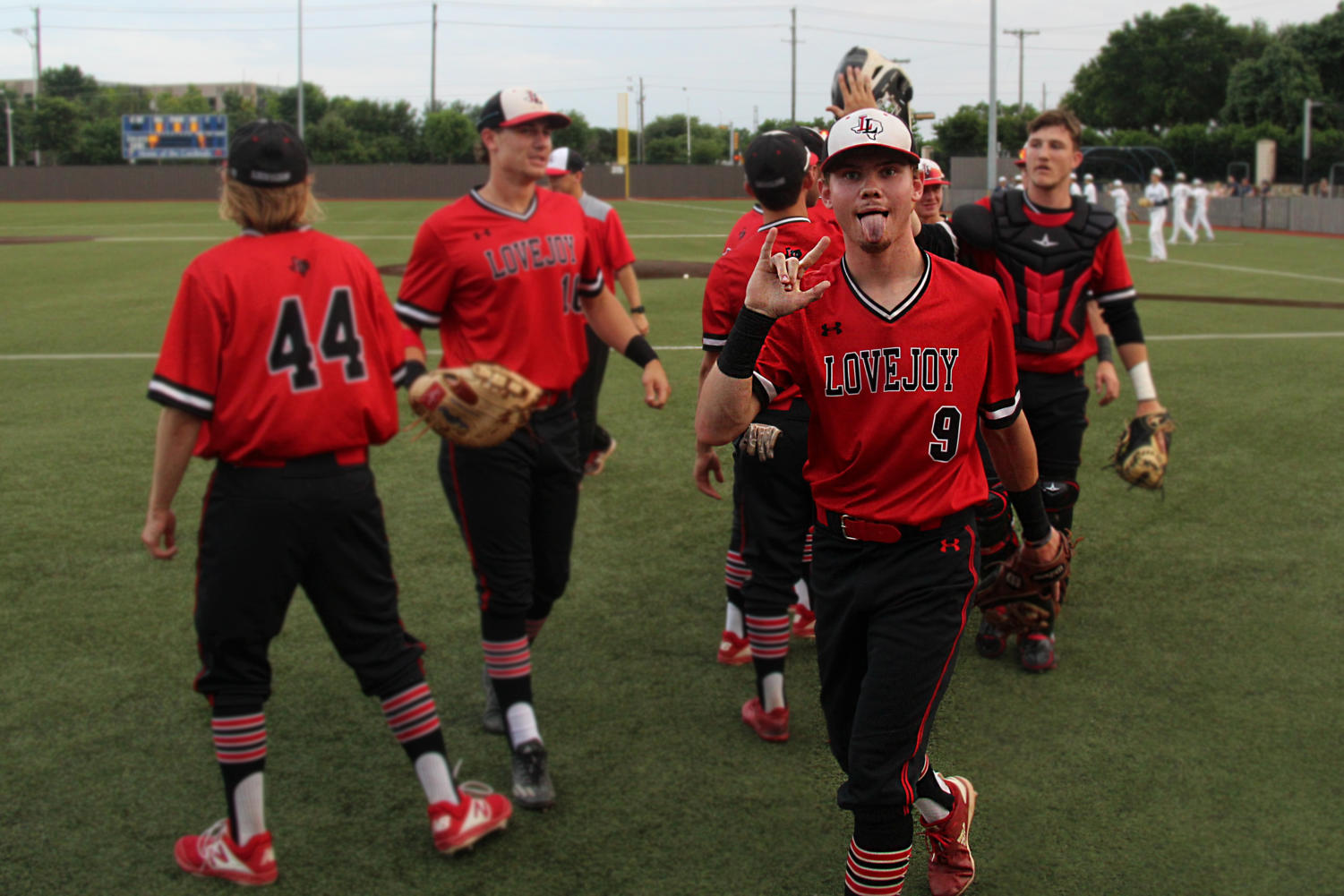 Senior+Jake+Terwilliger%2C+followed+by+his+teammates%2C+enters+the+dugout+after+celebrating+a+7-7+tie+on+the+field.+