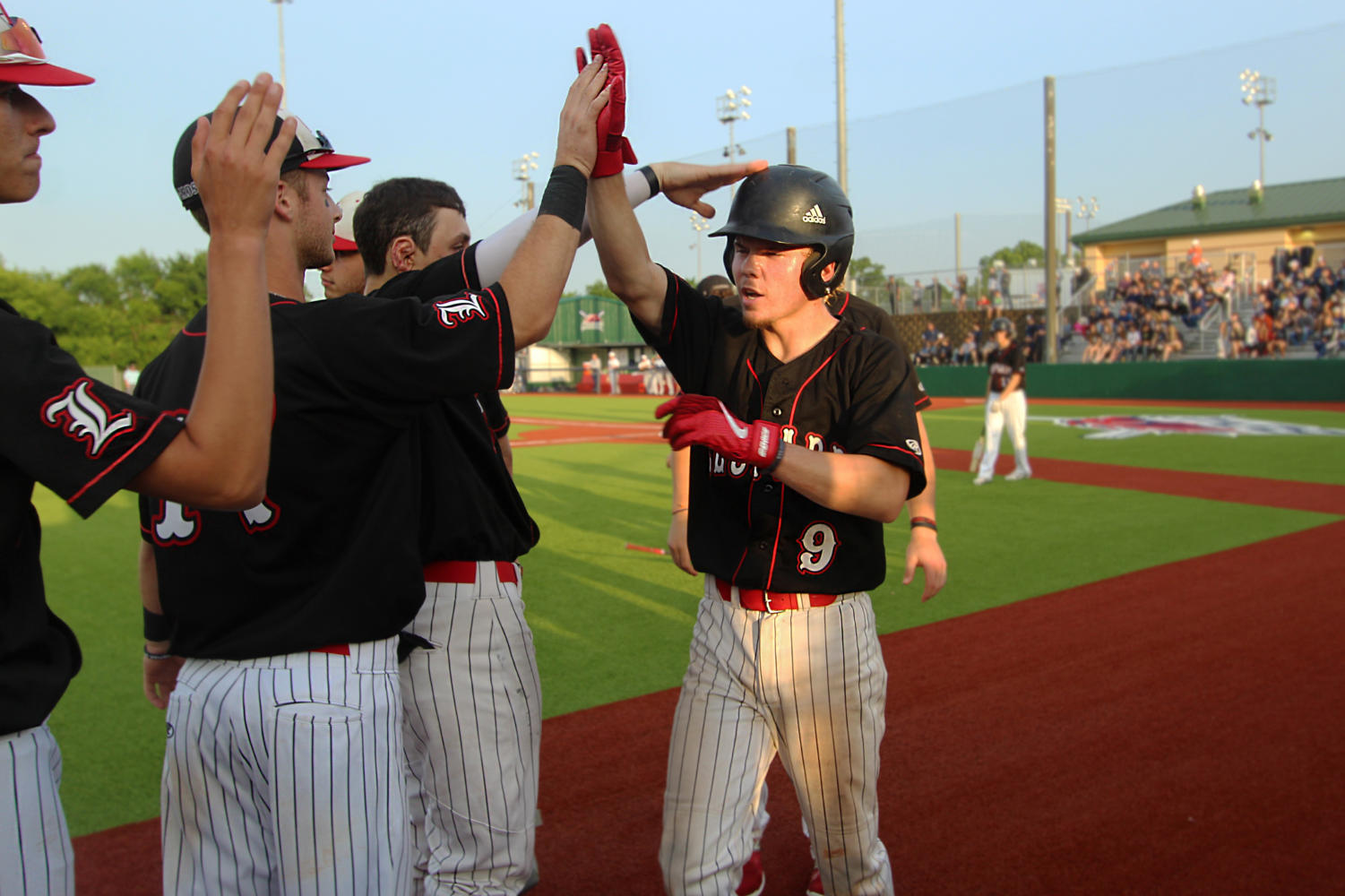 Senior+Jake+Terwilliger+is+greeted+by+junior+Ben+Nopper+after+a+successful+bat+in+the+fourth+inning.