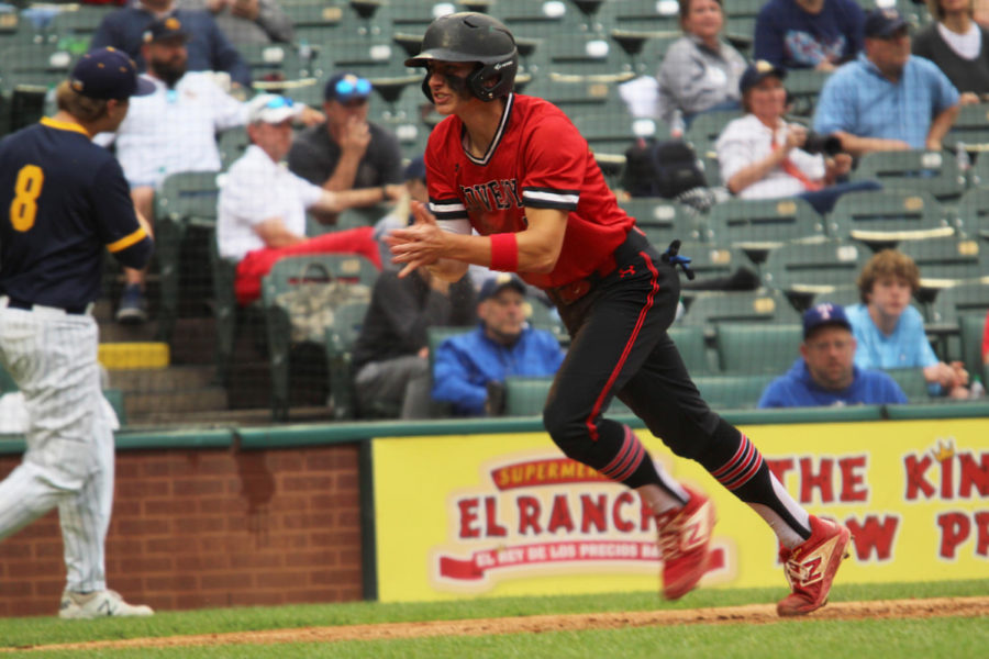 Senior Luke Finn runs through home plate after scoring a run. Finn later celebrated in the dugout with his teammates.