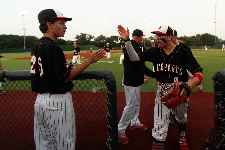 Junior+Garrett+Larson+congratulates+second+baseman+Luke+Finn+after+the+fifth+inning+as+he+enters+the+dugout.+