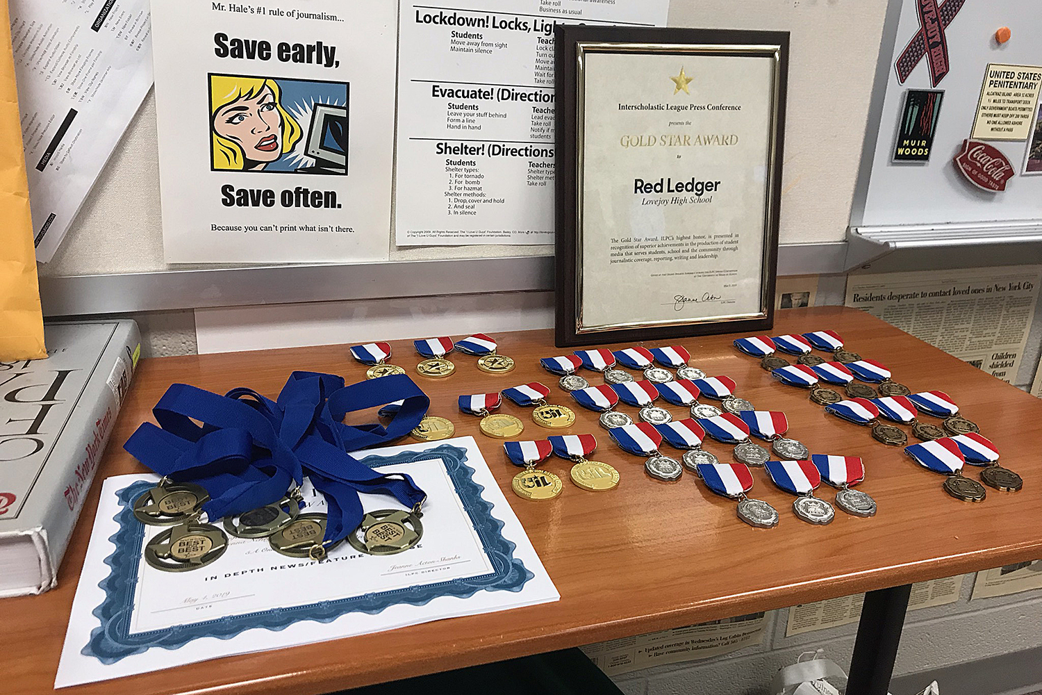 The medals and Gold Star won at the beginning of May by newspaper staffers are on display in the journalism room. The newspaper and broadcast staffs have won more than 200 individual awards this year and qualified eight students for the UIL All-State staff.