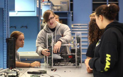 Sophomore Alyssa Vaughn builds her robot during the girls robotics club meeting.