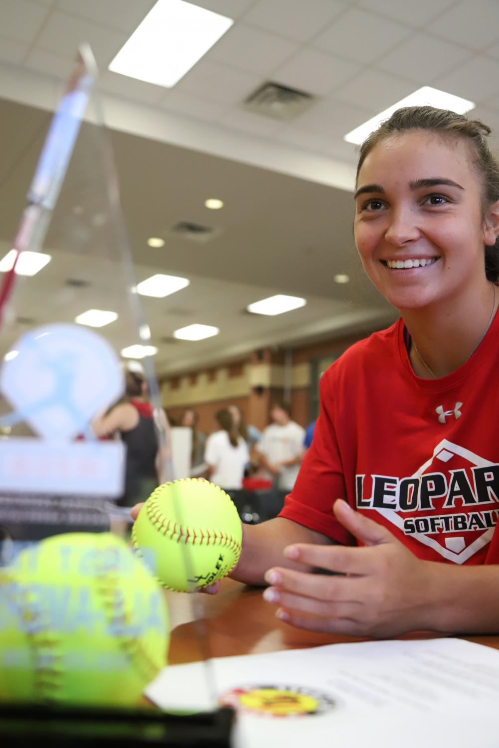 Senior+Carlee+Schaeffer+talks+to+freshman+Jade+Owens+about+the+Lovejoy+Softball+program.+Schaeffer+plays+second+base+for+the+Lady+Leopards+and+will+be+entering+her+fourth+and+final+year+of+playing+on+the+varsity+softball+team.