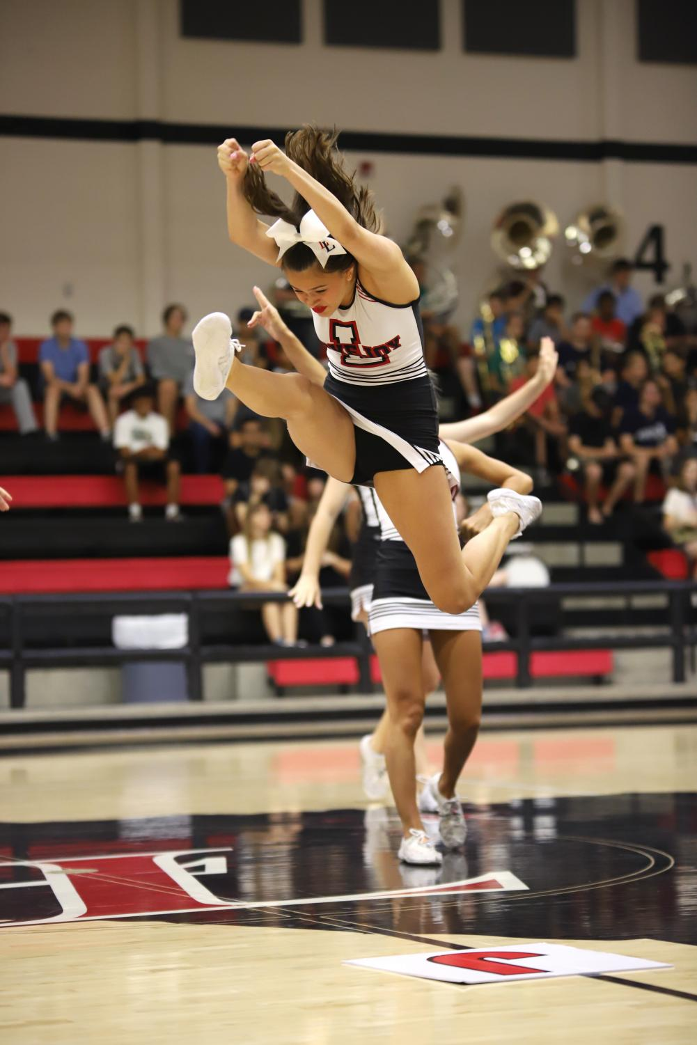 Senior+Taylor+Dismukes+jumps+into+a+herkie+during+the+beginning+portion+of+the+pep-rally.+Dismukes+is+the+captain+for+the+varsity+cheerleading+squad+this+year.