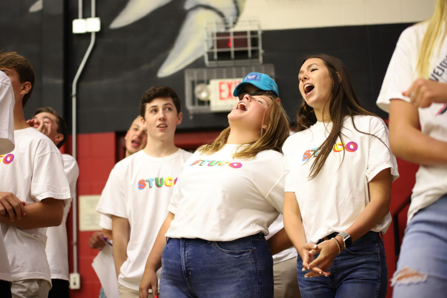 Senior+Student+council+president+Darby+Price+and+vice+president+Lily+McCutcheon+yell+out+the+fight+song+at+the+end+of+the+pep-rally.+The+pep-rally+was+ran+by+the+Student+Council+in+attempt+to+create+a+visual+of+what+high+school+pep-rallies+will+be+like.
