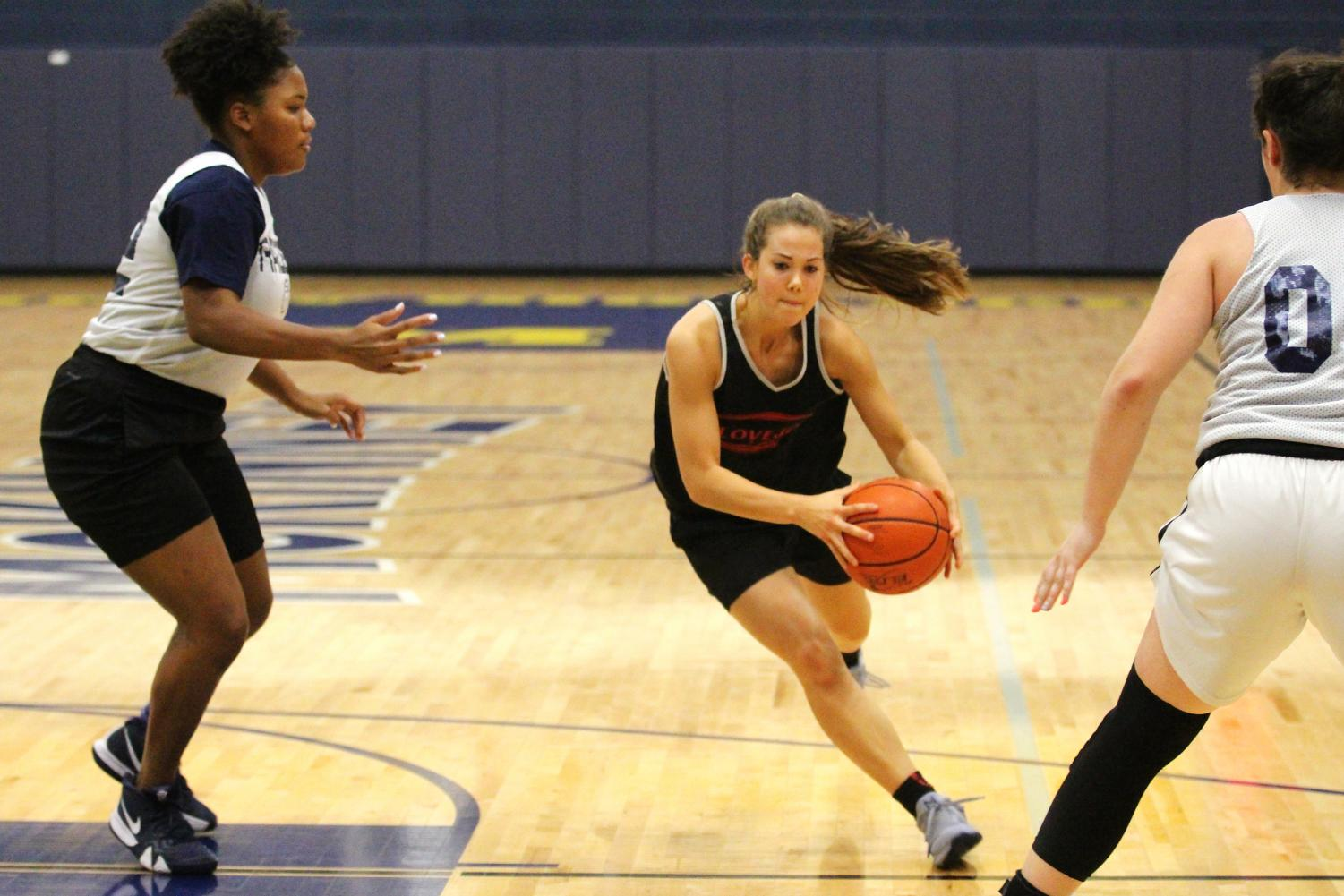 Senior Grace Bennet drives into the lane for a layup at the fall ball basketball game against Wylie East, a district opponent.