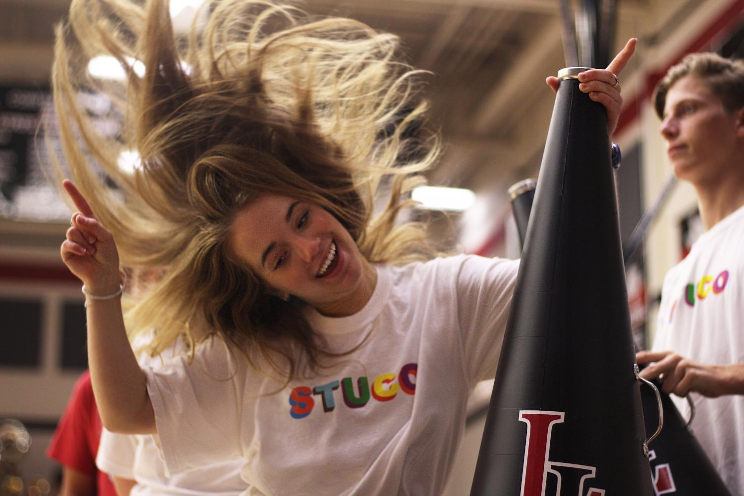 Senior+Student+Council+member+Halle+Meyer+dances+to+the+fight+song+at+the+conclusion+of+the+Founder%27s+Day+pep+rally.+Founder%27s+Day+was+comprised+of+several+different+events+showcasing+the+various+organizations+the+incoming+students+could+join.+