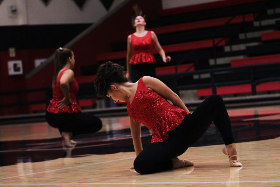 Senior Majestics Officer Jessica Luck poses on the ground during their performance to Paula Abdul's