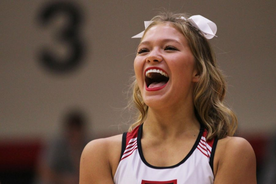 Cheerleader Grace Babic encourages the incoming freshmen during the squad's routine.