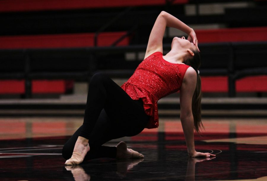 Majestics' Major Kylee Reinke poses on the floor during the Officer's performance.