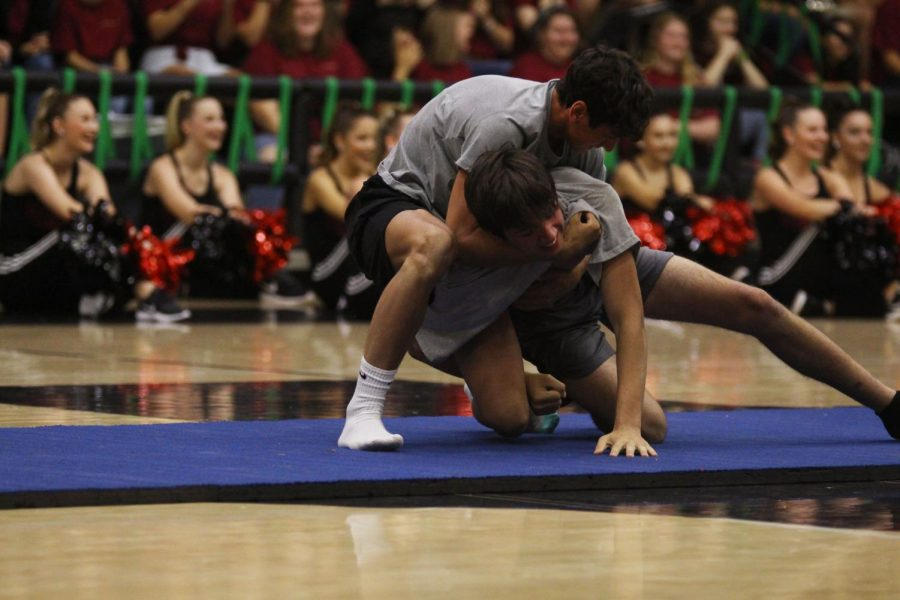 Sophomores Jakobi Edwards and Gavin Chassion wrestle to the ground trying to grab the other person's sock. Two representatives from each grade competed against each other. Edwards won for the sophomores.