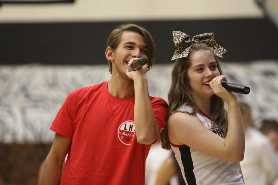 Senior Christian Cortez and Junior Caroline Dobbs sing the Lovejoy Alma Mater at the end of the pep rally along with the a capella. They performed a remix version of the traditional school anthem.