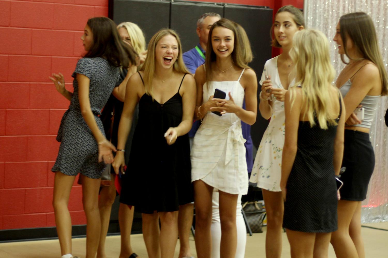 Seniors+Kristen+Lee%2C+Grace+Urban%2C+Wilson+Dean%2C+Maddie+Speicher%2C+and+Hannah+Kirby+laugh+while+waiting+for+the+photo+booth.+