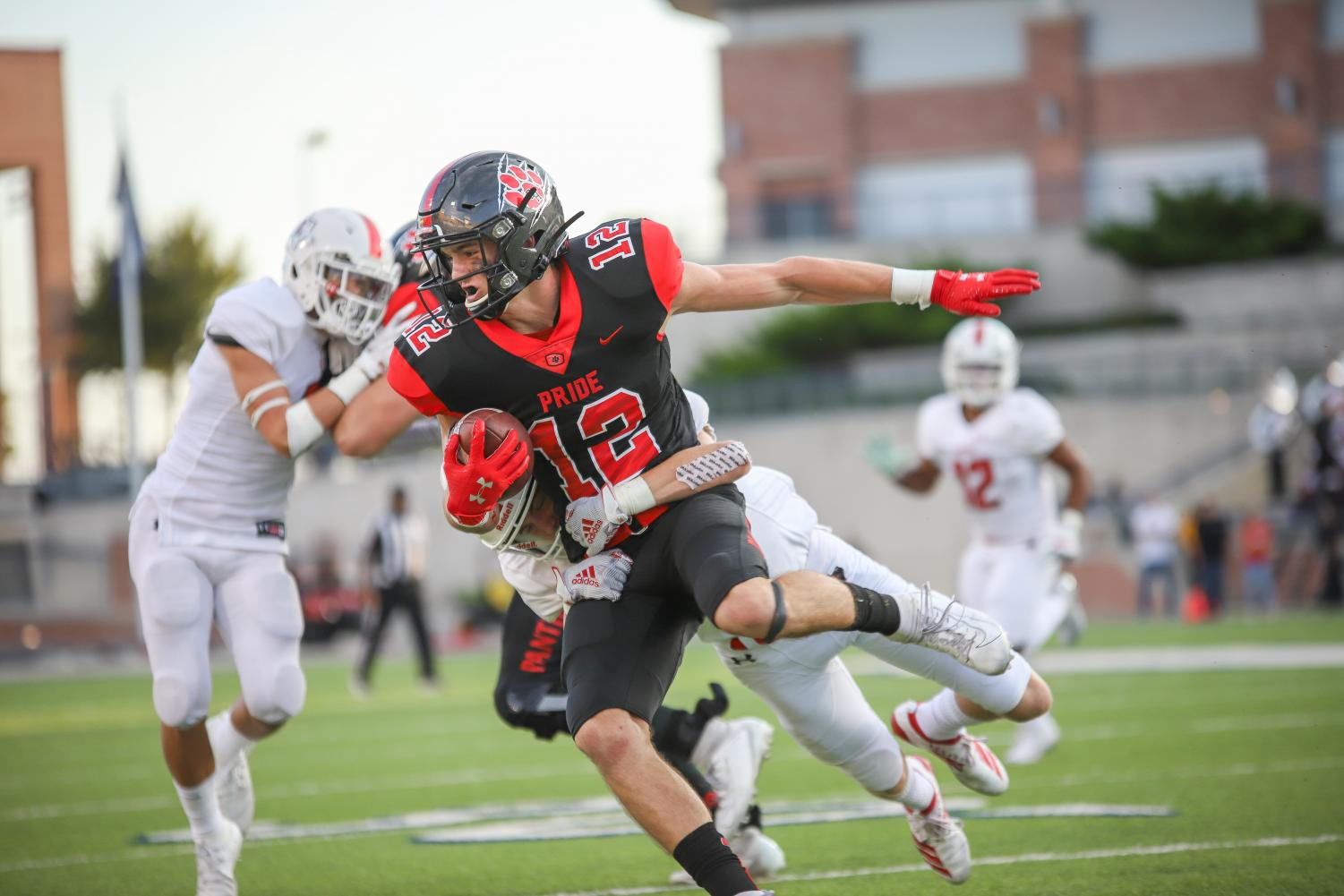 Colleyville+Heritage+wide+receiver+Brayden+Gerlich+%2812%29+attempts+to+run+the+ball+but+is+tackled+down+by+sophomore+Trent+Rucker+during+the+first+quarter.