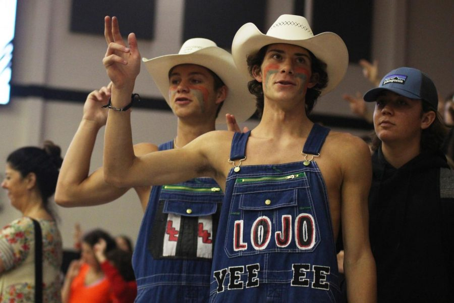 Hayes Anderson and Triton Freels, of the Dirty Drumline, sing the alma mater at the conclusion of the Pep Rally. The Dirty Drumline is notorious for the comedic overalls and school spirit.