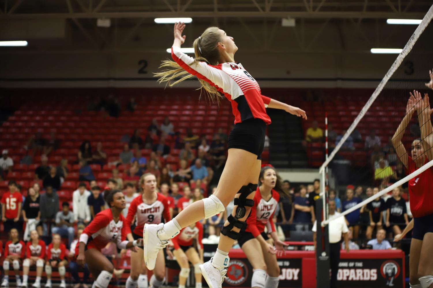 Junior+Brynn+Egger+elevates+to+hit+the+ball+over+Mckinney+Boyd+defenders+at+the+right+side+hitter+position.