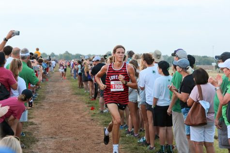 Senior Will Muirhead runs toward the finish line during the cross country meet on Saturday, Aug. 31. Muirhead placed 11th overall running 3.1 miles with a time of 15:37.40.