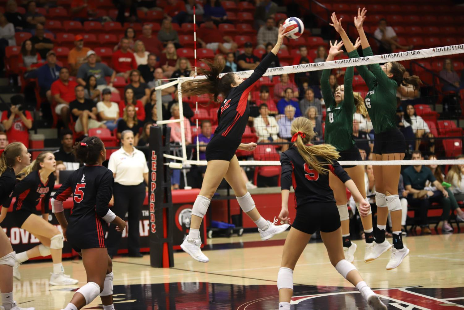 Freshman+Hannah+Gonzalez+hits+the+ball+from+the+middle+hitter+position.+Gonzalez+played+her+first+non-conference+home+game+on+the+court+in+a+Lovejoy+uniform+against+Prosper.