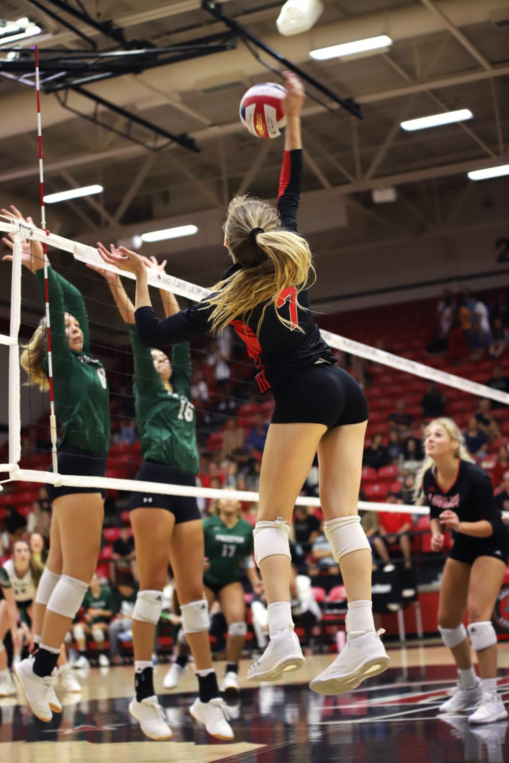 Junior+Ellie+Jonke+elevates+over+Prosper+defenders+to+get+the+kill.+The+Leopards+were+able+to+secure+the+victory+during+the+fourth+set+winning+25-21.