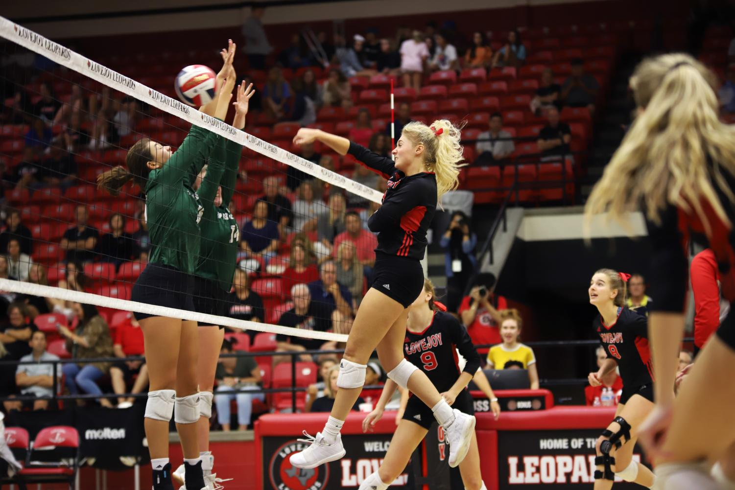 Junior+Libby+Olson+hits+the+ball+past+Propser+defenders+during+the+second+set+of+the+game.+The+team+lost+the+second+set+19-25.