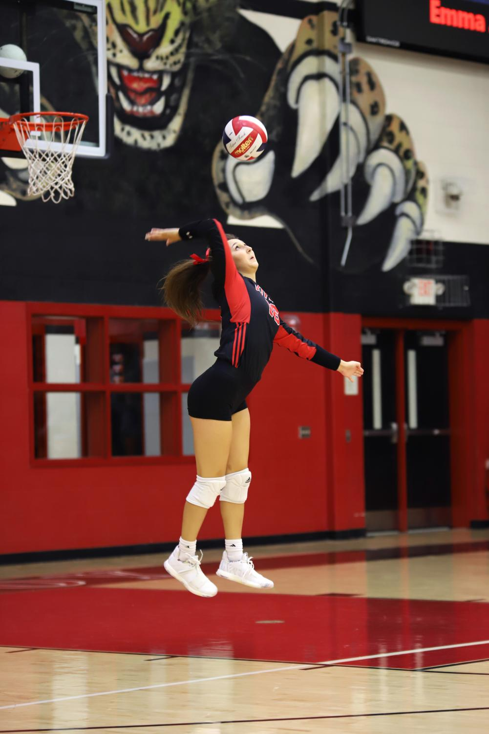 Senior+Emma+Johnson+jump+serves+during+the+first+set.+Johnson+plays+as+a+defensive+specialist+on+the+court.