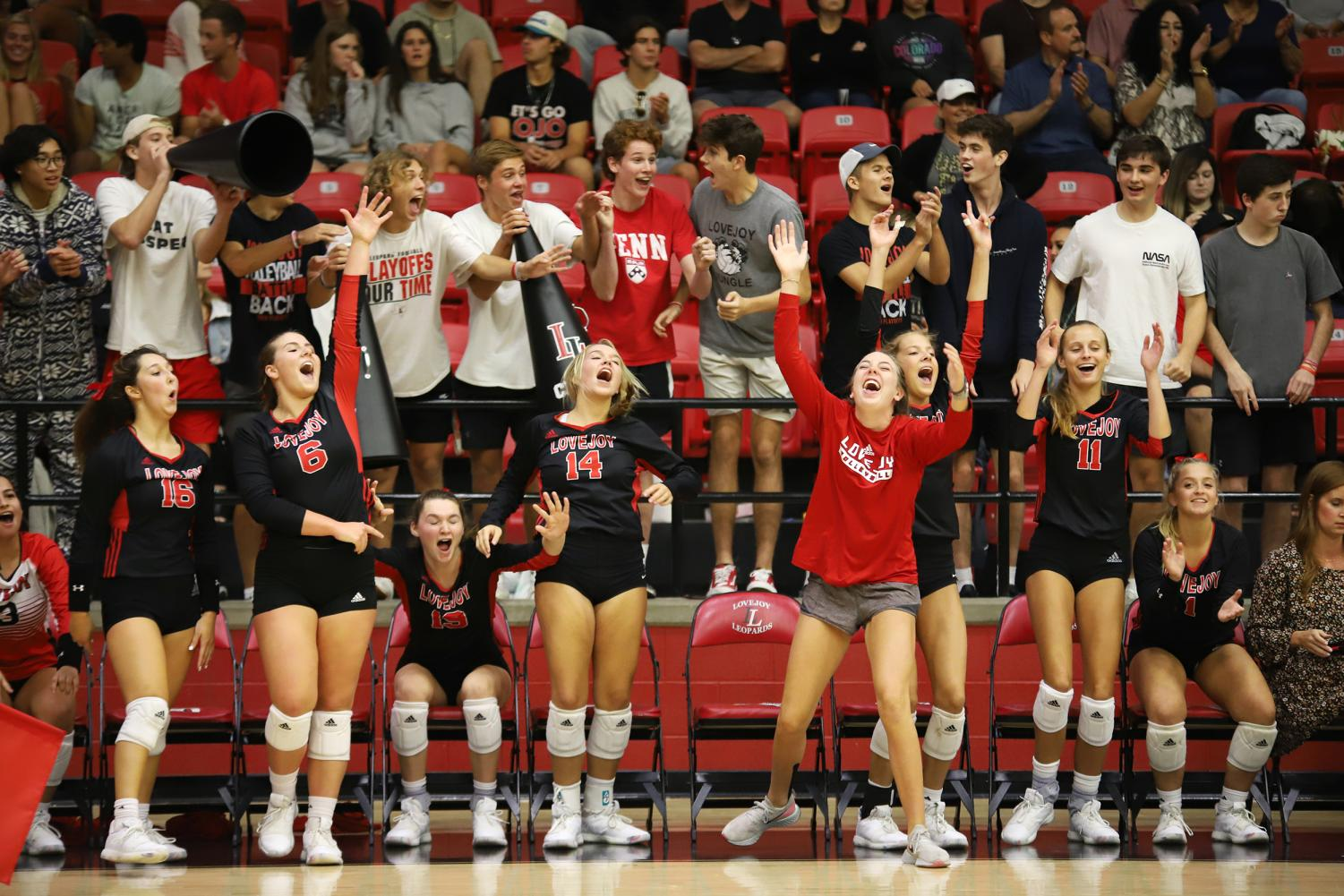 The+Lovejoy+volleyball+team+and+student+section+erupt+after+a+successful+block+during+the+third+set.