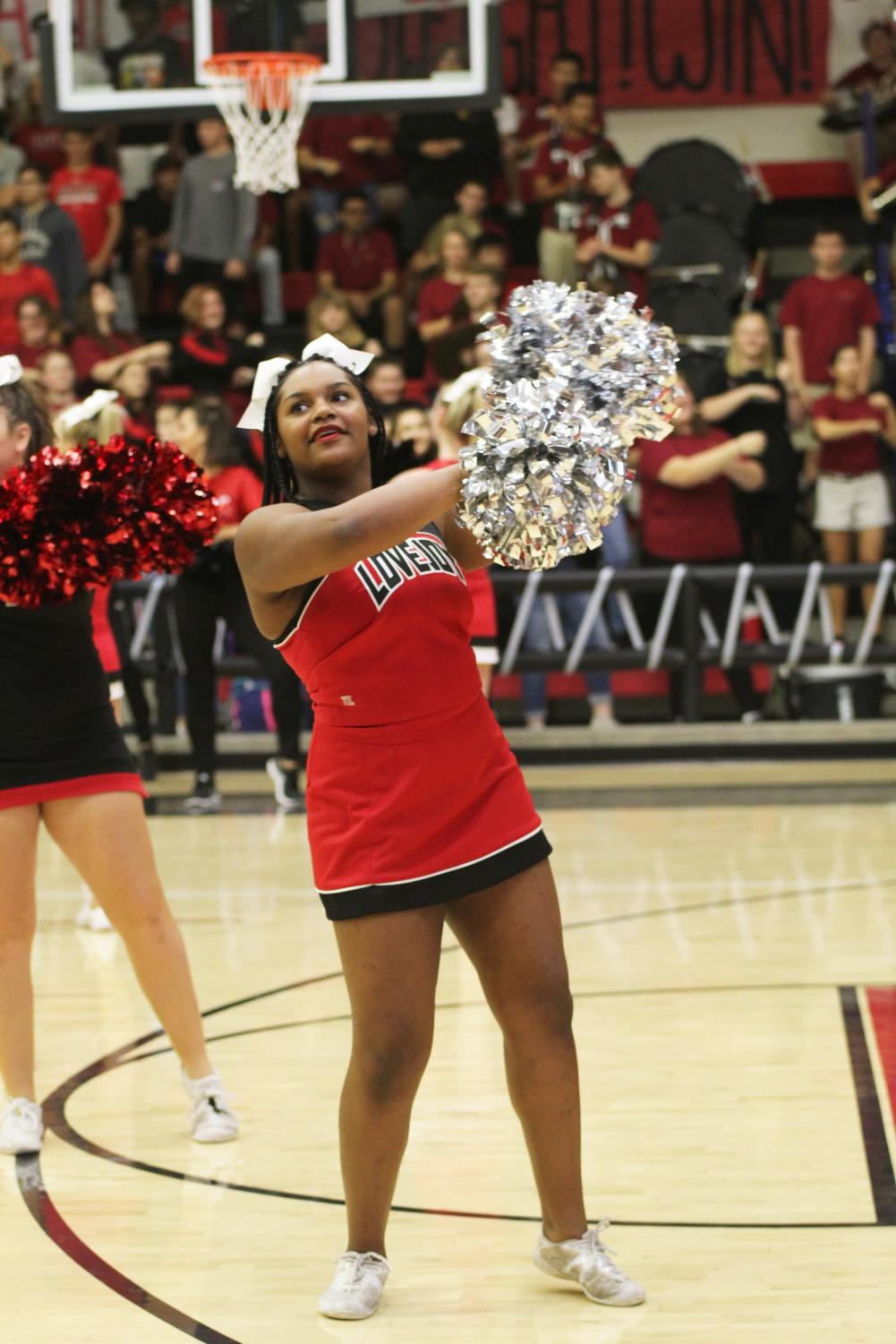 Cheerleader+Hannah+Patrick+performs+a+routine+during+the+pep+rally.+Hannah+has+been+cheering+for+LHS+for+three+years%2C+and+will+be+with+Varsity+at+tonight%27s+home+game.