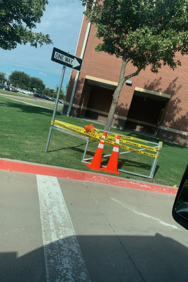 After the bar was cut to transport the truck, the remnants of the gate were surrounded with caution tape.