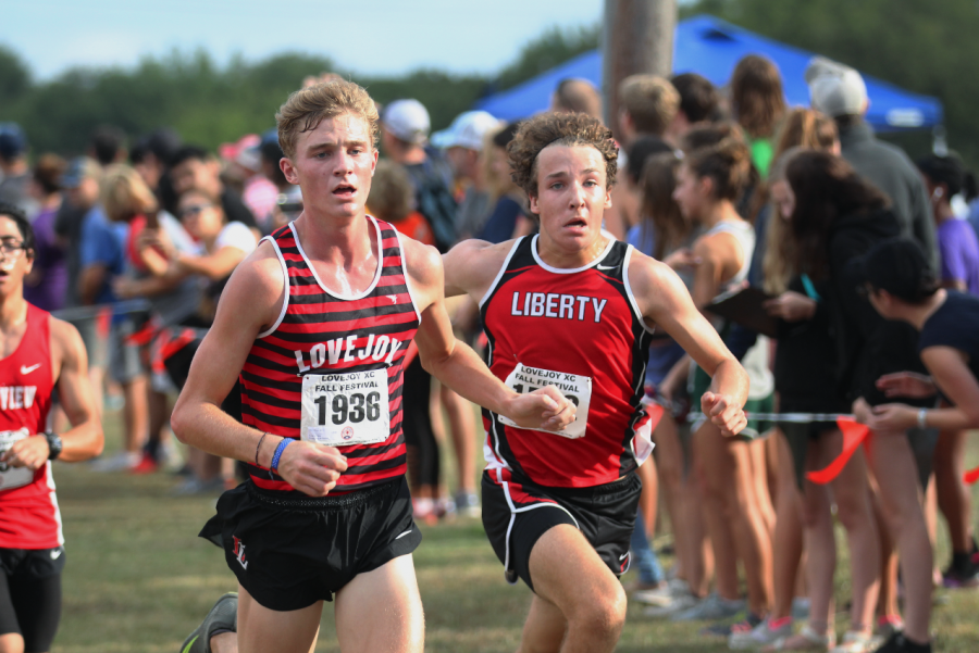Frisco Liberty Sophomore Chris Coppinger trails Senior Sam Rouse in the Division 1 Varsity boys race. Coppinger ended up beating Rouse by .03 seconds.