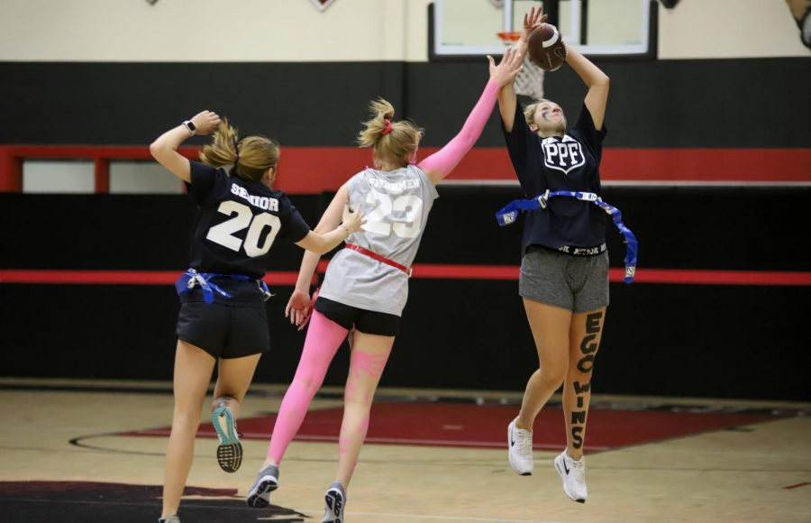 Senior Addison Hand intercepts the ball from freshman quarterback Hayley Trunks.