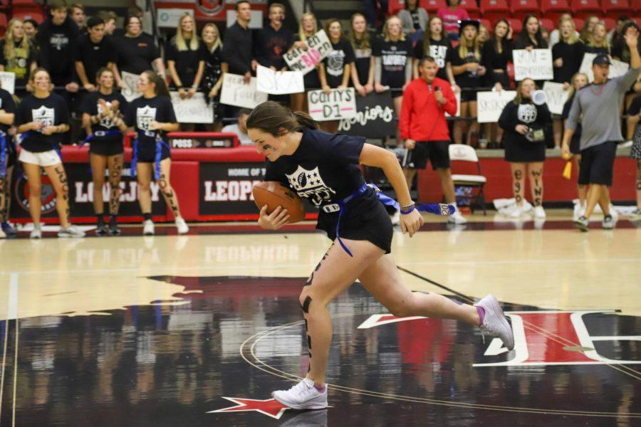 Senior Mackenzie Mitchell receives the ball from senior Lily Herran and runs past the freshman defense.