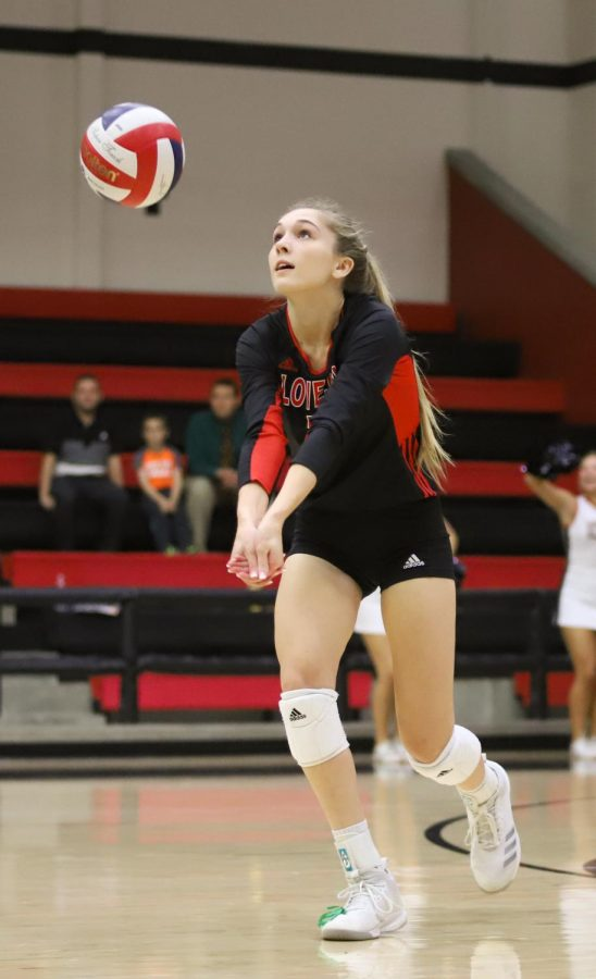 Junior Ellie Jonke defends the ball from Sherman's right side hitter during the first set. The Leopards won their first set 25-9.