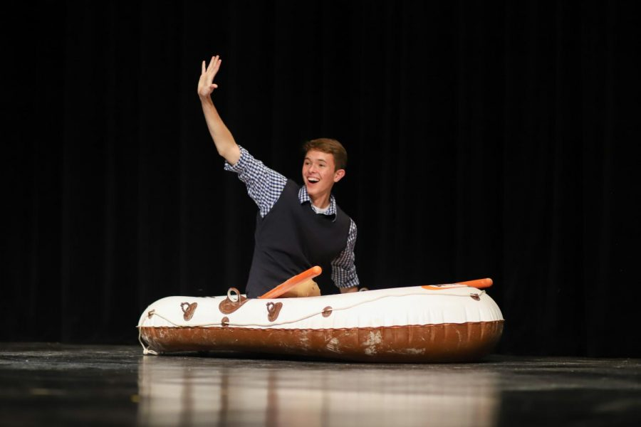 Senior Michael Walters rows onto the stage and waves to the crowd as he is introduced as a Mr. Lovejoy contestant.