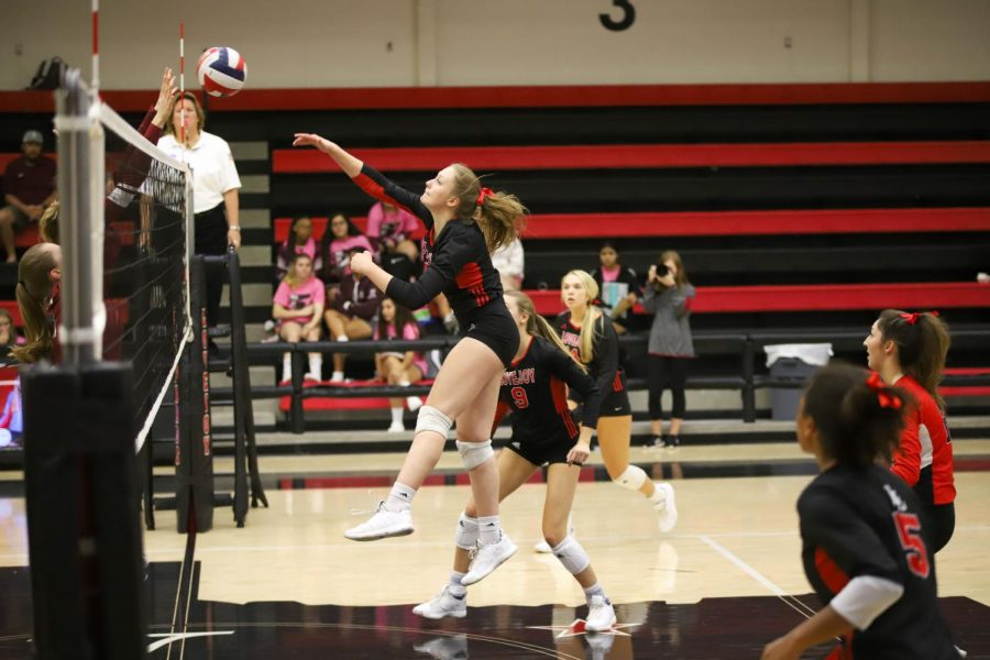 Senior Jentry Allen receives a set from sophomore Averi Carlson and hits the ball from the middle hitter position.