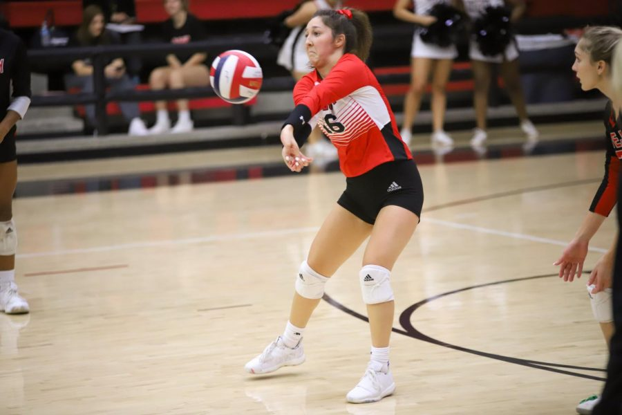 Senior Emma Johnson defends the ball from Sherman's outside hitter. The Leopards won their second set 25-12.