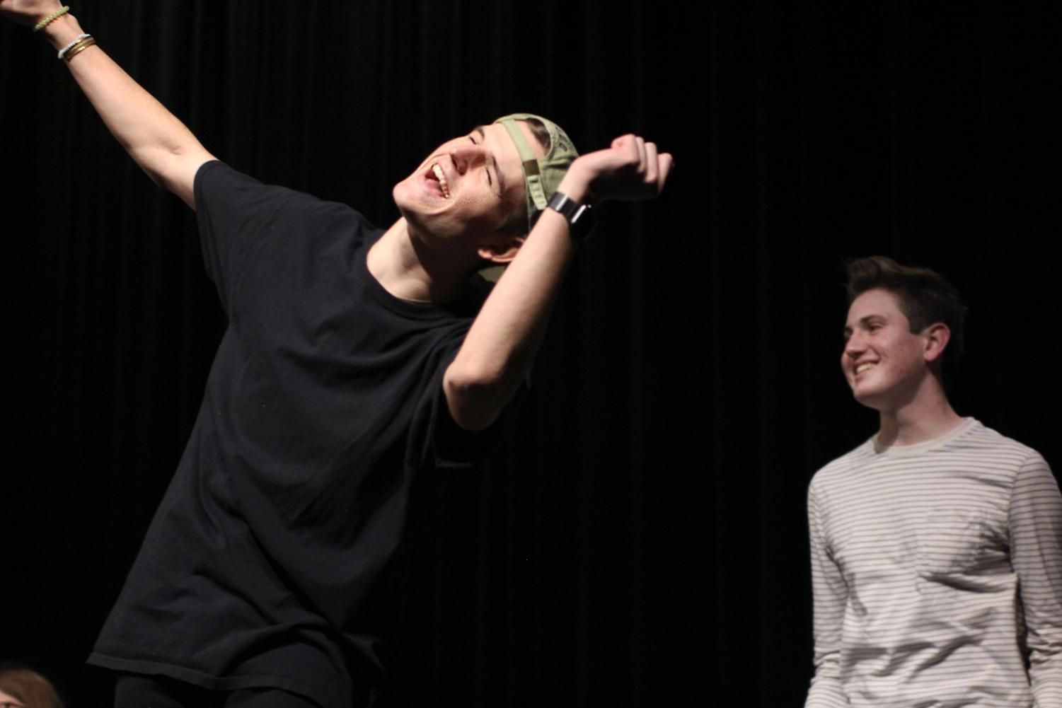 Senior Bryce Fuller and junior Jack Marsden entertain students during intermission at Mr. Lovejoy with an improv show.
