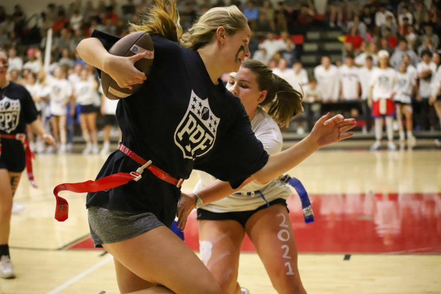 Senior Addison Hand evades junior defensive player Grace McLaughlin as she makes her way down the court.