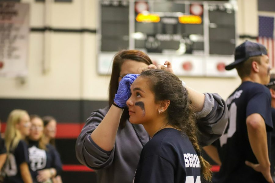 Senior Reagan Matacale is attended to by an athletic trainer after sustaining a minor head injury. Matacle returned to the game moments later.