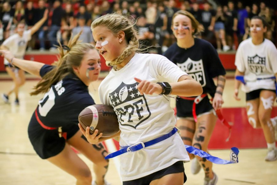 Junior Hannah Dunlap carries the ball down the court, outmaneuvering seniors Leah Taylor and Mallory Adamson.