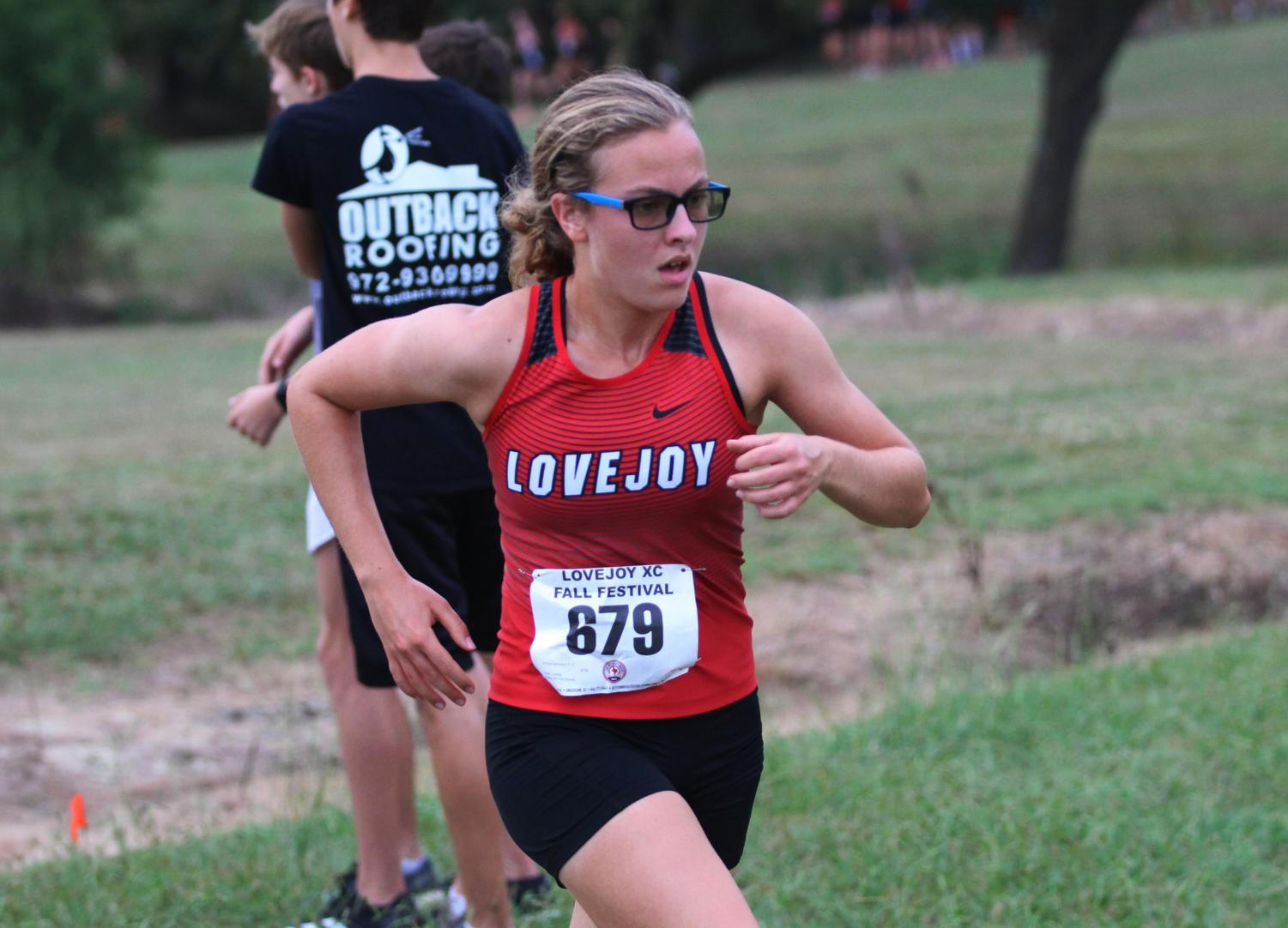 Junior Amelia Carothers runs in the Lovejoy Cross Country Fall Festival at Myers Park.