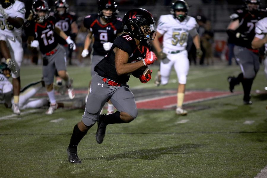 Sophomore Noah Naidoo is on the carry of the ball from the 50-yard-line. Naidoo is the starting running back for the Leopards.