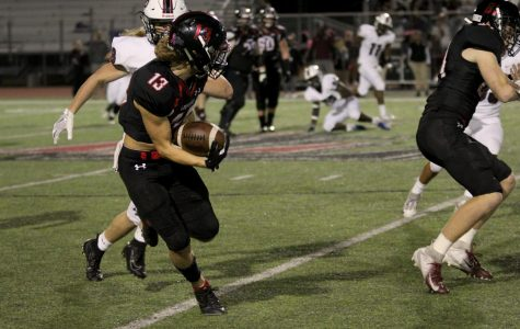 Junior Luke Mayfield runs the ball past the 45-yard-line to pick up a Lovejoy first down.