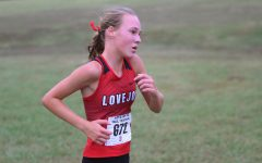 Sophomore Katie Armstrong races at the Lovejoy Fall Festival on Sept. 21. Armstrong finished the race with a time of 19:53.