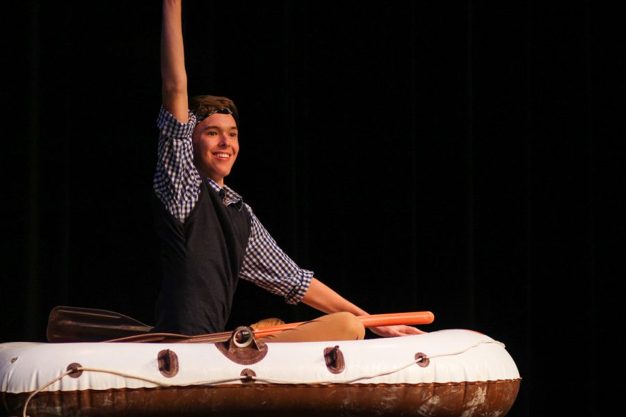 Mr. Lovejoy contestant Michael Walters rides his inflatable raft onto stage during his introduction.