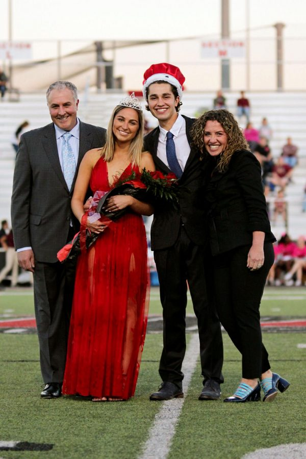 Seniors+Emily+Piccirillo+and+Matt+Piccirillo+are+announced+as+homecoming+king+and+queen+during+the+pre-game.+The+Piccirillo%27s+parents+walked+them+out%2C+and+upon+their+crowning%2C+their+parents+joined+them+to+take+pictures.+The+freshmen%2C+sophomore%2C+and+junior+homecoming+court+was+announced+at+the+pep+rally+that+morning.+