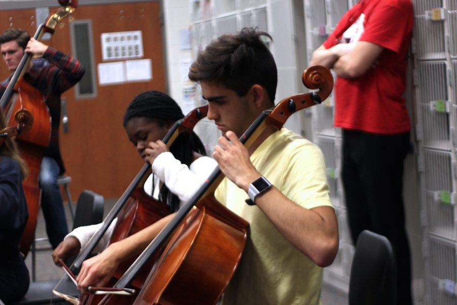 Junior+Grayson+Mousavijam+and+Freshman+Simi+Fadel+practice+their+cellos+in+preparation+for+their+annual+courtyard+concert+this+Monday%2C+October+28th.+They+will+be+playing+festive+halloween+music.%0A