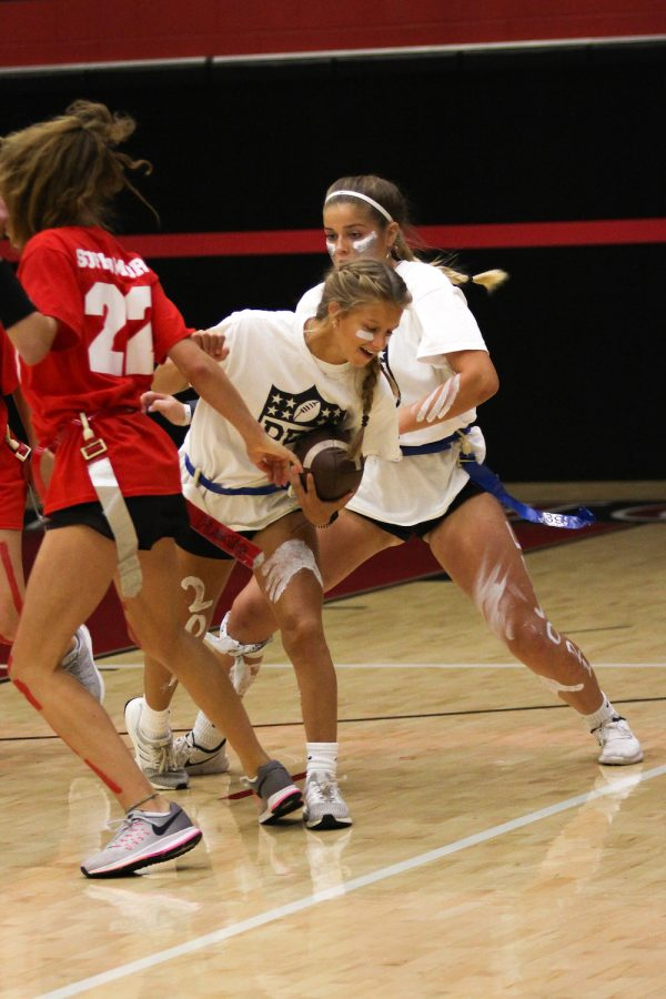 Junior Hannah Dunlap carries the football during their game against the Sophomores.