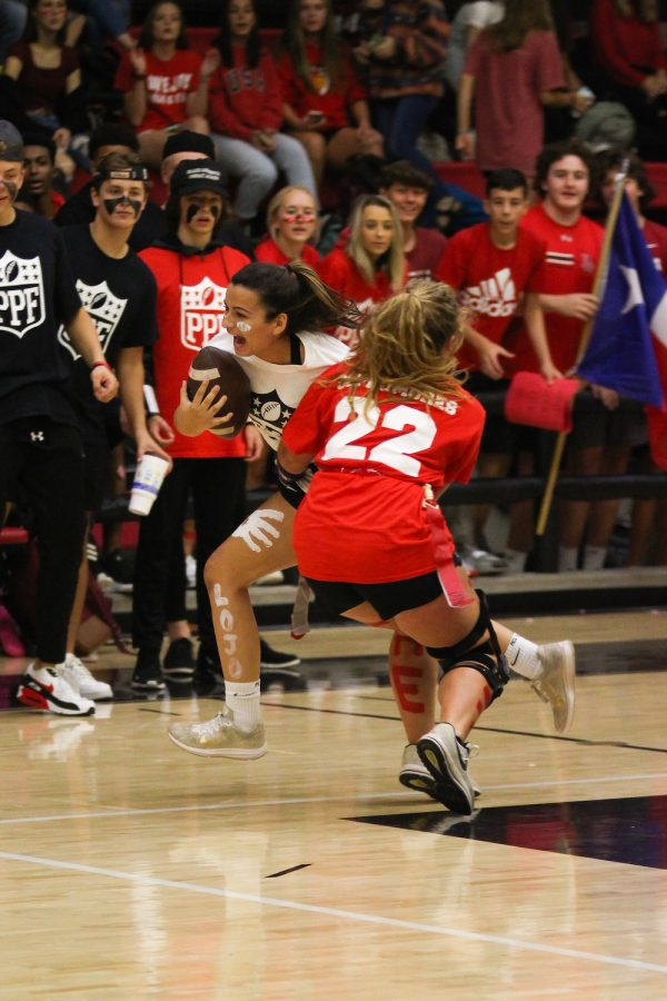 Junior Callie Kemohah evades a tackle during the game against the Sophomores.