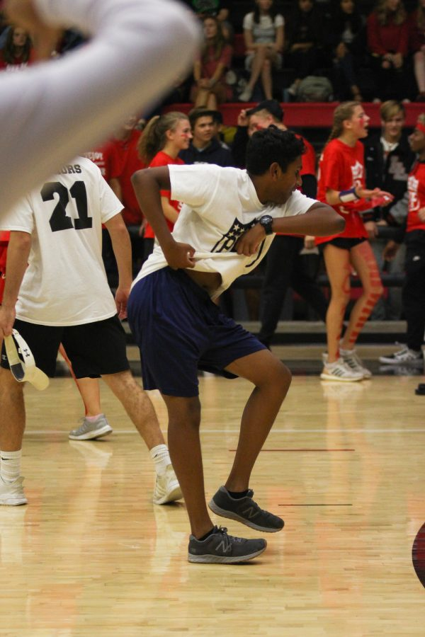 Junior Peter Godipelly dances to cheer up the crowd during halftime of the Junior versus Sophomore game.
