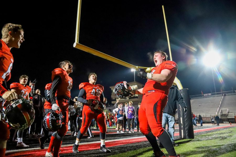 After the Lovejoy alma mater, senior Tyler Beidleman celebrates at the endzone with his teammates. The Leopards won in overtime against Denison 31-24.